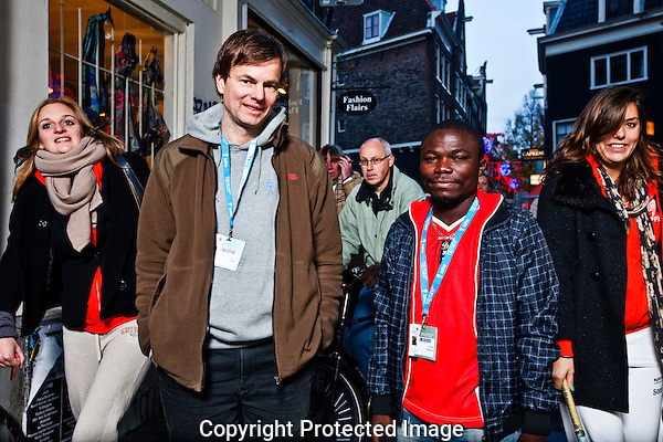 The Netherlands, Amsterdam, 21 November 2010. The 23rd International Documentary Film Festival Amsterdam (IDFA 2010). Portrait, from left (with blue/white badges); Martin Baer (co-director Kinshasa Symphony) and Dieudo Hamadi (co-director Congo in Four Acts). Photo: Bram Belloni /// © 2010 Bram Belloni, all rights reserved /// Copyright information: http://www.belloni.nl /// bram@belloni.nl /// +31626698929 /// Reference code: 101121046 Martin Baer - Dieudo Hamadi.jpg, The Netherlands/NLD, Amsterdam, 21NOV10