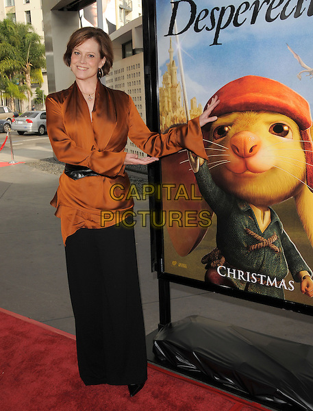 SIGOURNEY WEAVER .attends The Universal Pictures World Premiere of The Tale of Despereaux held at The Arclight Theatre in Hollywood, California, USA,.December 7th 2008                                                                     .full length orange top black waist belt blouse brown wide leg trousers hands silk .CAP/DVS.©Debbie VanStory/Capital Pictures