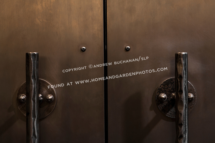 Architectural detail of unique hammered metal door handles