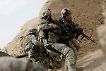 Pinned down under fire members of the 82nd Airborne, 1/508, Alpha Company, Third Platoon scramble for cover in Sangin, Helmand province, Afghanistan on Thursday, April 5, 2007. The firefight, less than 24 hours into the air assault on Sangin raged for over five hours.
