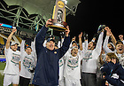 Dec 15, 2013; Notre Dame head coach Bobby Clark holds up the College Cup championship trophy as he celebrates with his team after they defeated Maryland 2-1. Photo by Barbara Johnston/University of Notre Dame