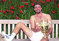 WIMBLEDON CHAMPIONSHIPS 2001 09/07/01 MENS FINAL GORAN IVANISEVIC (CROATIA) V PAT RAFTER GORAN IVANISEVIC WITH TROPHY AFTER FIVE SET WIN PHOTO ROGER PARKER