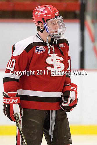 Greg Carey (St. Lawrence - 10) - The Harvard University Crimson defeated the St. Lawrence University Saints 4-3 on senior night Saturday, February 26, 2011, at Bright Hockey Center in Cambridge, Massachusetts.