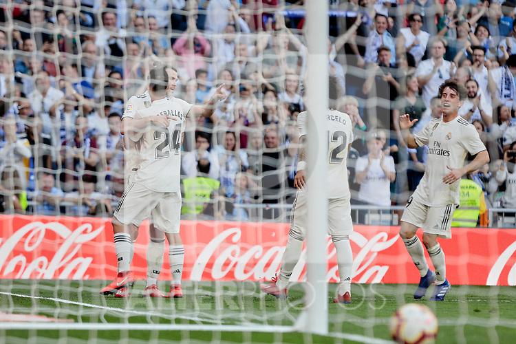 Real Madrid's Gareth Bale and Dani Ceballos celebrate goal during La Liga match between Real Madrid and Real Club Celta de Vigo at Santiago Bernabeu Stadium in Madrid, Spain. March 16, 2019. (ALTERPHOTOS/A. Perez Meca)