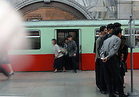"Commuters look at schedules of the Pyongyang Metro station in North Korea. The DPRK (Democratic People's Republic of Korea) is the last great dictatorship where the people are bombarded with images of the ""Eternal President"" Kim Il-sung who died in 1994 and his son and current leader Kim Jong-il who are worshipped like a God."