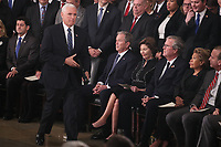 Vice President Mike Pence walks past former U.S. President George W. Bush, as well as his wife former first lady Laura Bush, brother former Florida Governor Jeb Bush, Jeb's wife Columba Bush and brother Marvin Bush as Pence takes the podium to speak about the president's father former President George H.W. Bush during ceremonies in the U.S. Capitol Rotunda in Washington, U.S., December 3, 2018. <br /> CAP/MPI/RS<br /> &copy;RS/MPI/Capital Pictures