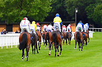 Runners ease up after finishing The Molson Coors Handicap  during Evening Racing at Salisbury Racecourse on 11th June 2019