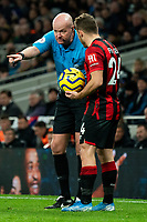 Referee Lee Mason directs Bournemouth's Ryan Fraser prior to his free kick<br /> <br /> Photographer Stephanie Meek/CameraSport<br /> <br /> The Premier League - Tottenham Hotspur v Bournemouth - Saturday 30th November 2019 - Tottenham Hotspur Stadium - London<br /> <br /> World Copyright © 2019 CameraSport. All rights reserved. 43 Linden Ave. Countesthorpe. Leicester. England. LE8 5PG - Tel: +44 (0) 116 277 4147 - admin@camerasport.com - www.camerasport.com