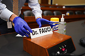 The name tag for Dr. Anthony  Fauci,  the Director of the National Institute for Allergy and Infectious Diseases, is placed at his seat before he arrives to testify before the House Committee on Energy and Commerce on the Trump Administration's Response to the COVID-19 Pandemic, on Capitol Hill in Washington, DC on Tuesday, June 23, 2020.    <br /> Credit: Kevin Dietsch / Pool via CNP