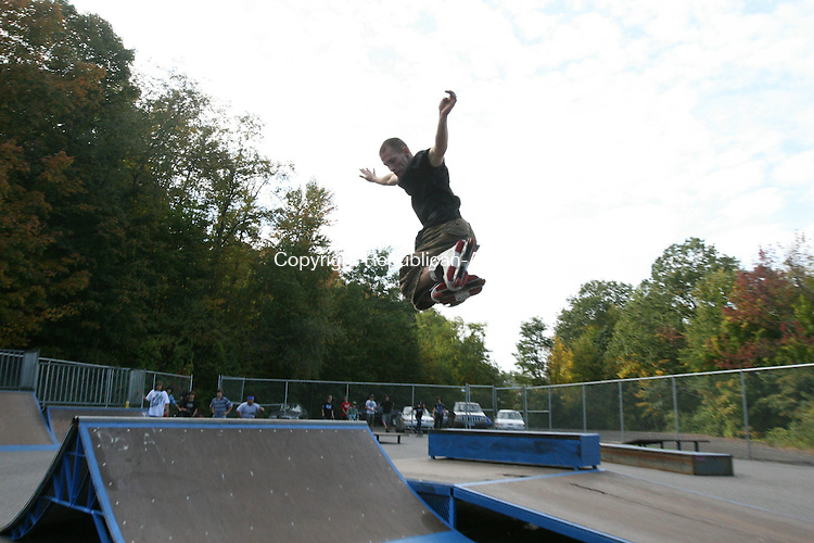 WINSTED, CT - 1 October, 2008 - 100108MO01 - Local resident Travis Madden, 22, catches some air Wednesday at the Winsted Skate Park, which reopened this week following a three-month effort to repair damaged ramps. Town officials estimate upwards of $5,000 was saved by doing most of the work in-house. Jim Moore Republican-American.