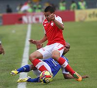 BOGOTÁ-COLOMBIA- 27-01-2013.Carlos Arias de Santa Fe y Lewis Ochoa de Millonarios. (Photo: VizzorImage/ Felipe Caicedo)