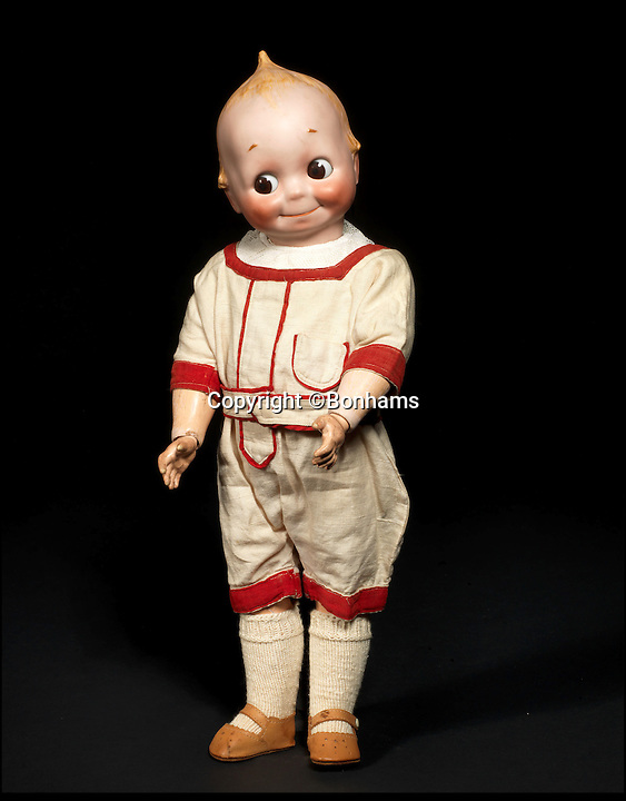 BNPS.co.uk (01202 558833)<br /> Pic: Bonhams/BNPS<br /> <br /> ***Please Use Full Byline***<br /> <br /> J.D Kestner Bisque Head 'Kewpie' Googly-eyed doll. <br /> <br /> Well Hello Dolly  - &pound;1million doll collection sells at Bonhams.<br /> <br /> A creepy collection of almost 100 'lifelike' dolls modelled on children has sold for hearly &pound;1million. <br /> <br /> The eerie-looking toys were made in Germany in the early 20th century as dollmakers strived to produce dolls with realistic human features.<br /> <br /> The collection of 92 dolls, which includes some of the rarest ever made, has been pieced together by a European enthusiast over the past 30 years.