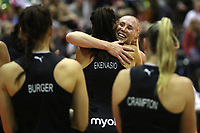 19.01.2019 Silver Ferns Laura Longman is hugged by her team mates after her 150th match during the Silver Ferns v Australia netball test match at The Copper Box Arena. Mandatory Photo Credit ©Michael Bradley Photography/Christopher Lee