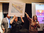 Melinda Terry, Executive Director, North Delta Water Agency, points to a poster, held by Barbara Barrigan-Parrilla, depicting a conceptual rendering of an on-bank intake facility for the Delta Tunnel project at the Restore The Delta public meeting at Lone Tree Golf & Event Center in Antioch, California, on Thursday, March 6th, 2014. Photo/Victoria Sheridan