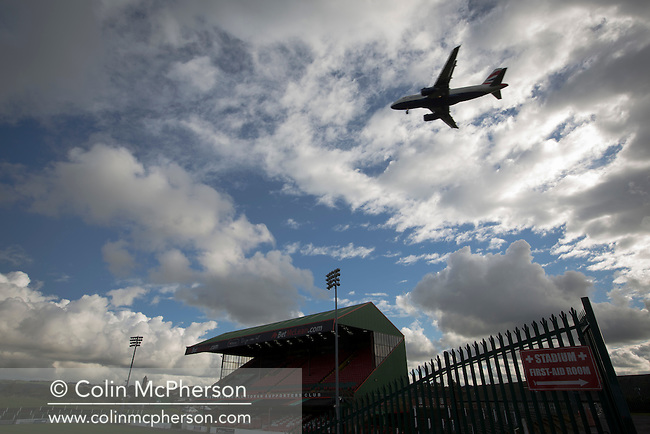 An aircraft coming into land at the nearby George Best International Airport near The Oval, Belfast, pictured before Glentoran hosted city-rivals Cliftonville in an NIFL Premiership match. Glentoran, formed in 1892, have been based at The Oval since their formation and are historically one of Northern Ireland's 'big two' football clubs. They had an unprecendentally bad start to the 2016-17 league campaign, but came from behind to win this fixture 2-1, watched by a crowd of 1872.