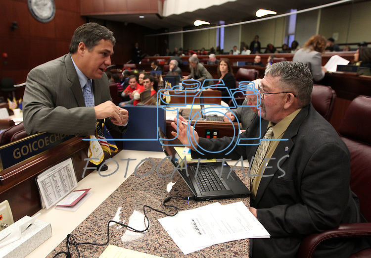 Nevada Assembly Majority Leader Marcus Conklin, D-Las Vegas, left, talks with Assembly Minority Leader Pete Goicoechea, R-Eureka, on the Assembly floor at the Legislature in Carson City, Nev., on Monday, March 21, 2011. Photo by Cathleen Allison