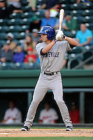 Left fielder Max White (13) of the Asheville Tourists bats in a game against the Greenville Drive on Monday, April 21, 2014, at Fluor Field at the West End in Greenville, South Carolina. White is the No. 26 prospect of the Colorado Rockies, according to Baseball America.  Greenville won, 8-3. (Tom Priddy/Four Seam Images)
