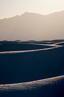 Sand dunes stretch to the San Andres Mountains west of White Sands National Monument near Alamogordo, New Mexico, USA, on Sat., Dec. 30, 2017.