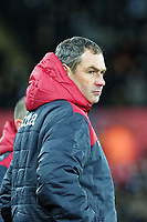 Swansea manager Paul Clement stands on the touchline during the Premier League match between Swansea City and Manchester City at The Liberty Stadium, Swansea, Wales, UK. Wednesday 13 December 2017