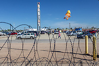 "MEXICALI, MEXICO - April 5 ""Baby Trump"" Balloon is seen floating thru barbed wire in a protest against the President of the United States on April 5, 2019 in Mexicali, Mexico.<br /> President Trump on Friday visited Calexico, a small city in a largely agricultural region between Arizona and the Pacific, to inspect an upgraded portion of fencing and to meet with law enforcement. That's more attention than usual for a border town that locals say is defined by its interconnection with Mexico, its infernal summers and its labor-based economy. <br /> (Photo by Luis Boza/VIEWpress)"