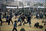 Anti-Shah demonstrators in 24 of Esfand Square on the run after the army opens fire. Tehran, December 27, 1978
