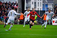 Sunday, 23 November 2012<br /> <br /> Pictured: Leon Britain of Swansea City Chico Flores of Swansea City Wayne Rooney of Manchester United and Ashley Williams of Swansea City<br /> <br /> Re: Barclays Premier League, Swansea City FC v Manchester United at the Liberty Stadium, south Wales.