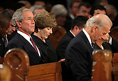 Boston, MA - August 29, 2009 -- Former President George W. Bush sits behind Vice President Joe Biden (R). during funeral services for U.S. Senator Edward Kennedy at the Basilica of Our Lady of  Perpetual Help in Boston, Massachusetts August 29, 2009.  Senator Kennedy died late Tuesday after a battle with cancer. .Credit: Brian Snyder- Pool via CNP