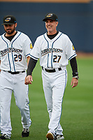 Akron RubberDucks pitching coach Tony Arnold (27) walks to the dugout with pitcher Tanner Tully (29) before an Eastern League game against the Reading Fightin Phils on June 4, 2019 at Canal Park in Akron, Ohio.  Akron defeated Reading 8-5.  (Mike Janes/Four Seam Images)