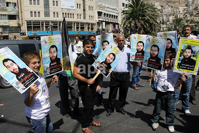 Palestinians take part in a protest calling for release of the Palestinian prisoner in Israeli jails Hasan al-Safadi who is still refusing food since 21 June 2012 , during a demonstration in support him, in the West Bank, city of Nablus on Sept. 15, 2012. Photo by Nedal Eshtayah