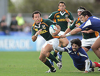 South African centre Francois Hougaard slips out of the tackle from French full back Mathieu Belie during the Division A U19 World Championship clash at Ravenhill.