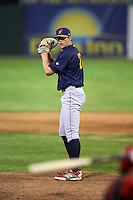 State College Spikes relief pitcher Greg Tomchick (27) gets ready to deliver a pitch during a game against the Batavia Muckdogs on June 23, 2016 at Dwyer Stadium in Batavia, New York.  State College defeated Batavia 8-4.  (Mike Janes/Four Seam Images)