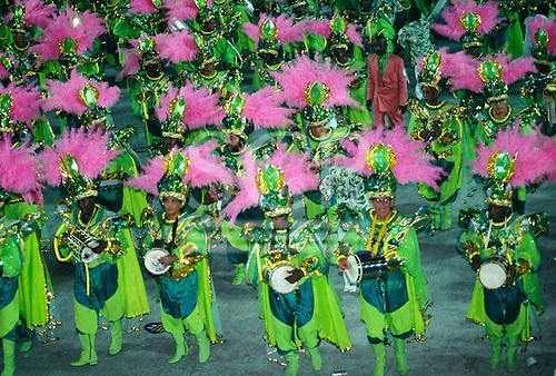 Rio de Janeiro, Brazil. Part of the Mangueira Samba School carnival parade bateria playing cuica.