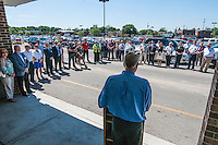 Hadler Company CEO George Hadler talks to the crowd gathered before the start of the demolition of a large portion of Westerville Square Shopping Center to make way for the construction of a new WalMart store in the Columbus suburb. The store will approximately 108,000-square-feet, about half the  size of a traditional WalMart super store..