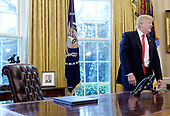United States President Donald Trump stands in the Oval Office after speaking about trade at the White House March 31, 2017 in Washington, DC. <br /> Credit: Olivier Douliery / Pool via CNP