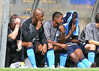 Three Wycombe players sit in the home dug-out watching the match. From left to right, Leon Johnson, Gavin Grant and Nathan Ashton during Wycombe Wanderers vs Southend United, Friendly Match Football at Adams Park on 2nd August 2008
