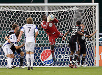 Bill Hamid (28) of D.C. United pulls in a save at RFK Stadium in Washington, DC.  D.C. United defeated the Kansas City Wizards, 2-1.