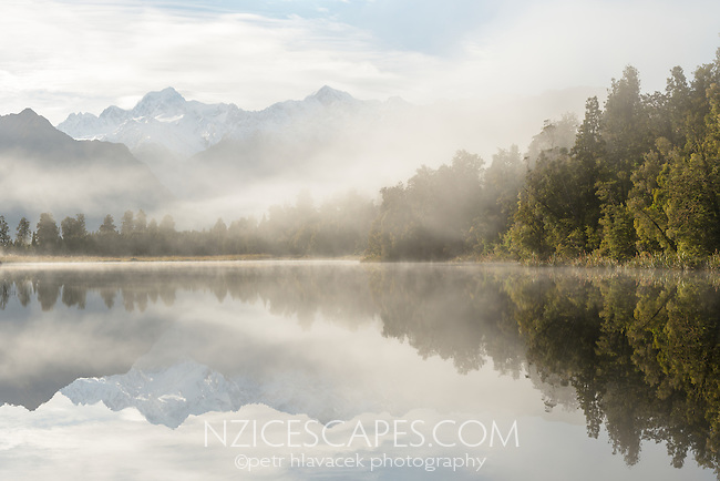 Southern Alps with Mount Tasman and Aoraki Mount Cook reflecting in Lake Matheson at sunrise, Westland Tai Poutini National Park, UNESCO World Heritage Area, West Coast, New Zealand, NZ