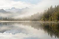 Southern Alps with Mount Tasman and Aoraki Mount Cook reflecting in Lake Matheson at sunrise, Westland Tai Poutini National Park, UNESCO World Heritage Area, West Coast, New Zealand, NZ