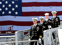 Gary Wilcox/staff... 03/23/07.... Capt. Todd Zecchin Leads the remaining crew members off the ship at the end of the decommissioning ceremony. The USS John F. Kennedy (CV 67) was decommissioned at Naval Station Mayport, Friday.