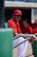 Clearwater Threshers hitting coach Rob Ducey (22) in the dugout during the first game of a doubleheader against the Lakeland Flying Tigers on June 14, 2017 at Spectrum Field in Clearwater, Florida.  Lakeland defeated Clearwater 5-1.  (Mike Janes/Four Seam Images)