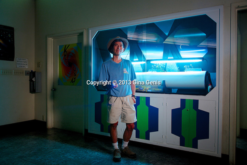 Larry Kawano in front of the Aquaponics display he designed.