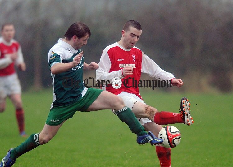 Brendan Dillon puts in a challenge on Newmarket's David O' Grady. Photograph by Declan Monaghan
