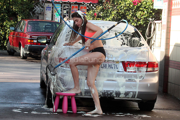 WEST HOLLYWOOD, CA - APRIL 2: Actress Alicia Arden seen washing her car in West Hollywood, California on April 2, 2015. Credit: David Edwards/DailyCeleb/MediaPunch