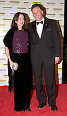 "Democratic National Committee Chairman Terence R. McAuliffe and his wife, Dorothy, arrive at the Harry S. Truman Building (Department of State) in Washington, D.C. on December 4, 2004 for a dinner hosted by United States Secretary of State Colin Powell.  At the dinner six performing arts legends will receive the Kennedy Center Honors of 2004.  This is the 27th year that the honors have been bestowed on ""extraordinary individuals whose unique and abundant artistry has contributed significantly to the cultural life of our nation and the world"" said John F. Kennedy Center for the Performing Arts Chairman Stephen A. Schwarzman.  The award recipients are: actor, director, producer, and writer Warren Beatty; husband-and-wife actors, writers and producers Ossie Davis and Ruby Dee; singer and composer Elton John; soprano Joan Sutherland; and composer and conductor John Williams.<br /> Credit: Ron Sachs / CNP"