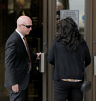 NWA Arkansas Democrat-Gazette/DAVID GOTTSCHALK Former state representative Micah Neal (left) enters Thursday, September 13, 2018, with his wife Cindy the John Paul Hammerschmidt Federal Building in Fayetteville. Neal was to be sentenced for conspiracy to commit fraud in kickback scheme involving state General Improvement Fund grants.