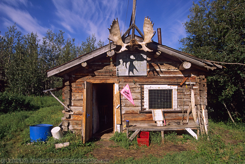 Rustic log cabin along the Yukon River, Canada
