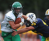 Kevin Wilson #34 of Farmingdale, left, fights for yards during a Nassau County Conference I varsity football game against host Massapequa High School on Saturday, Sept. 22, 2018. He ran for three touchdowns. Farmingdale won by a score of 41-27.
