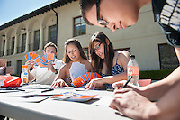 Evita Chavez '15, right.<br /> Tuition meets just 60% of the cost of an Oxy education, and this week marks the point where gifts to the College start paying the bills. Students stopped in the Quad today to write thank-you notes to Oxy supporters as part of 60-40 Week. Feb. 23, 2012. (Photo by Marc Campos, Occidental College Photographer)