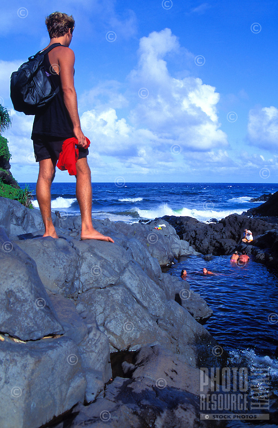 Hiker overlooking Seven Sacred Pools near Hana on Maui.