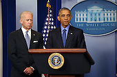United States President Barack Obama makes a statement in the Brady Press Briefing Room of the White House on yesterday's church shooting in Charleston, SC, in Washington, Thursday, June 18, 2015. At left is US Vice President Joe Biden.<br /> Credit: Martin H. Simon / Pool via CNP